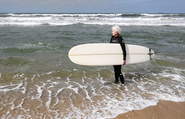 Bob Phillips surfs at Bolsa Chica State Beach