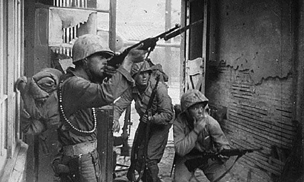 Bob is in the middle sporting an M-1 rifle which was standard issue at the time